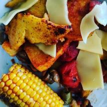 Polenta, vegan gouda, cherry tomatoes, mushrooms, corn on the cob