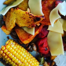 Polenta, vegan gouda, cherry tomatoes, mushrooms, corn on the cob