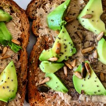 Peanut butter, seeds and avocado on toast